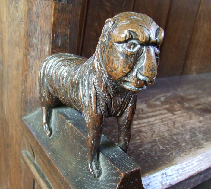 Wimbotsham Norfolk St Mary bench end human faced quadruped